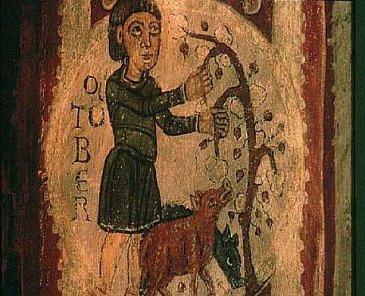 Reproduction médiévale d'un paysan nourrissant ses porcs de glands